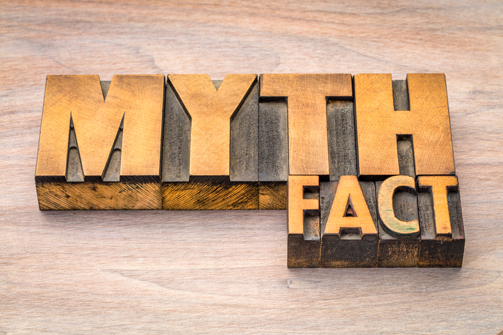 myth and fact word abstract in letterpress wood type printing blocks against grained wood